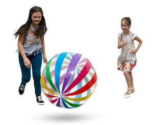 two girls playing with a beach ball