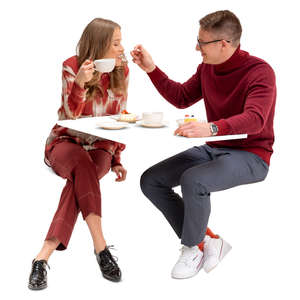 couple eating cake in a restaurant