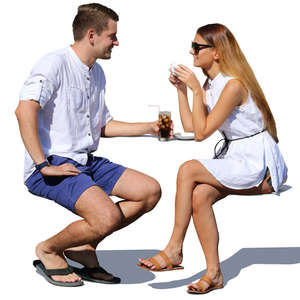 couple sitting and talking a street cafe in summertime