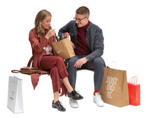 man and woman with shopping bags sitting