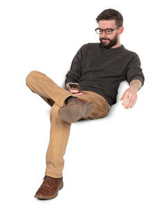 man sitting and texting