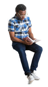 black man sitting and reading a book