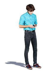 young man standing and checking his phone