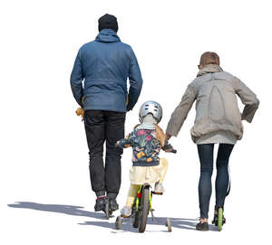 family with bicycle and scooter