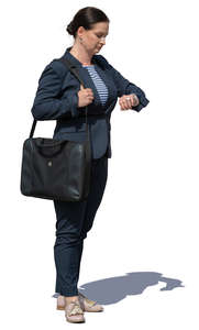 businesswoman standing and checking her watch