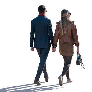 man and woman walking hand in hand on a spring day