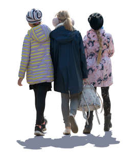 three backlit girls walking