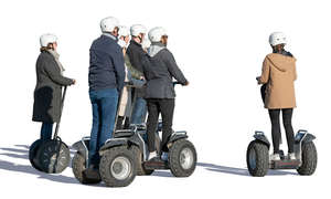 group of adults riding segways