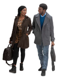 black man and woman walking and talking