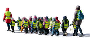 group of kindergarten children walking on the street