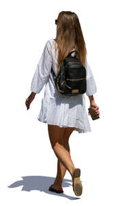 woman in a white summer dress walking