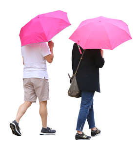 two people with pink umbrellas walking