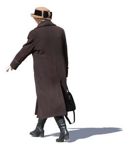 older woman in a brown overcoat walking
