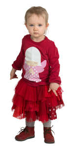 little girl in a red party dress standing