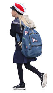 schoolgirl with a school bag walking