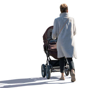 sidelit woman with a baby carriage walking