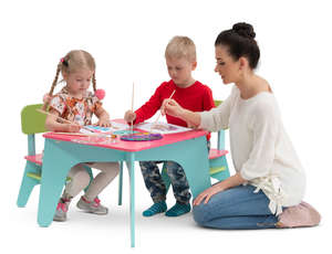 children painting at childrens play table