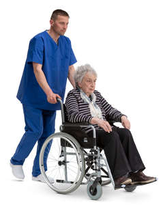 nurse pushing a woman in a wheelchair