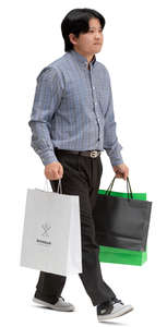 asian man with shopping bags walking