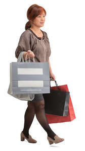 asian woman with shopping bags walking