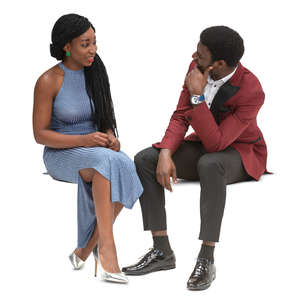 black man and woman sitting and talking