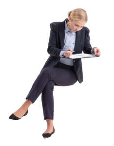 businesswoman sitting and writing notes