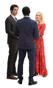 group of three people standing and talking