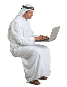 arab man sitting and working with computer