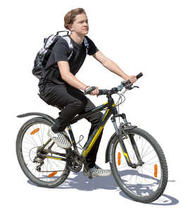 teenage boy riding a bike