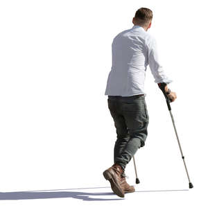man walking with crutches