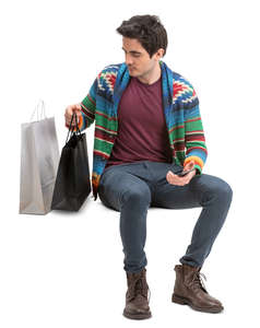 man with shopping bags sitting