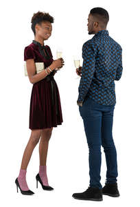 man and woman talking at a party