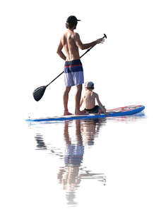 father and son paddleboarding