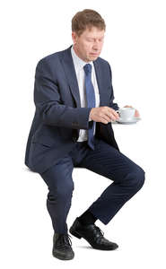 businessman sitting and drinking coffee