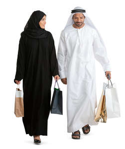 arab man and woman with shopping bags walking
