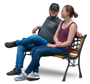 couple sitting on a bench and talking