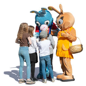 children talking with two big rabbits