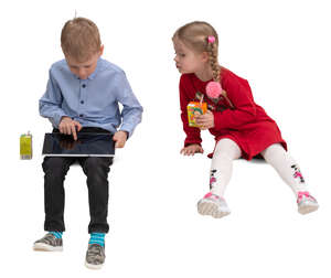 boy and girl sitting and looking at a tablet