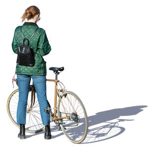 woman with a bicycle standing and texting