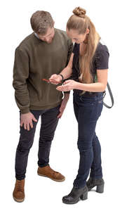 man and woman looking at a phone and talking