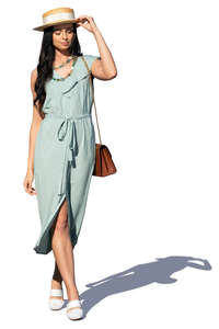 woman in a pale blue summer dress walking