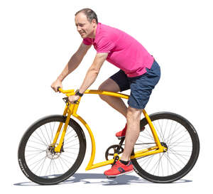 man riding a yellow bike