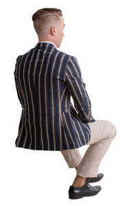 man in a striped jacket sitting