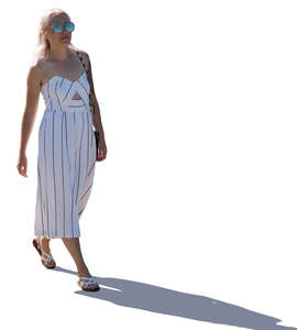 backlit woman walking