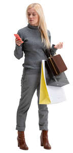 woman with many shopping bags standing