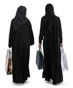 two arab women with shopping bags walking