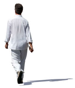 man in a white outfit walking