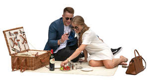 man and woman having a fancy picnic