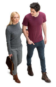 man and woman walking arm in arm seen from above