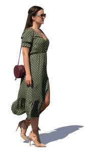 woman in a green dress walking